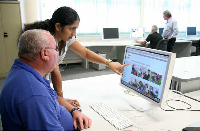 Mackay TAFE student Ryan Buckton, tutor Niveditha Dopathi, student George Kuncir and IT teacher Lawrie Comben mastering the basics of web design.
