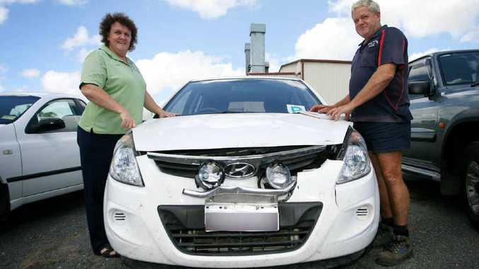 Karen McMaster and Gary Morse from Morse Panel Works at Gracemere say at least one vehicle a week comes in for repairs after an accident on the Capricorn Hwy.
