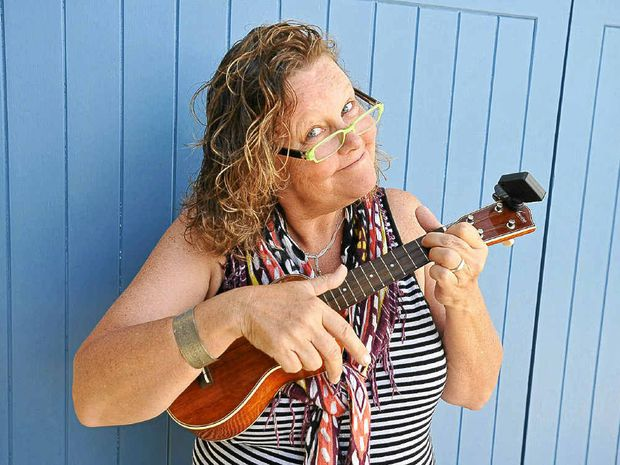 Ukulele devotee Denise Patten tunes up.