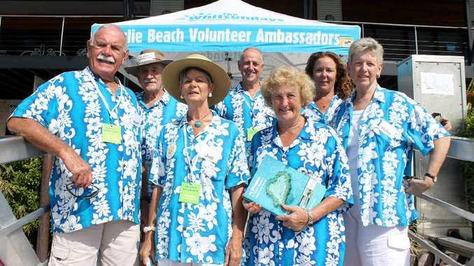 Whitsunday cruise ship ambassadors (from left) Keith Dunn, Graham Wyatt, Judi Dunn, Eric Loft, Ruth Boast, Emma Banks and Helen Loft prepare to welcome Queen Mary 2 passengers at Abel Point Marina.