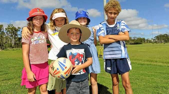 (L-R) Dakota Edwards, 7, Zanthia Edwards, 8, Emma Pearce, 7, Caleb McLelland, 12 and Declan Edwards, 4, will enjoy the new lights system at Callemondah Oval.