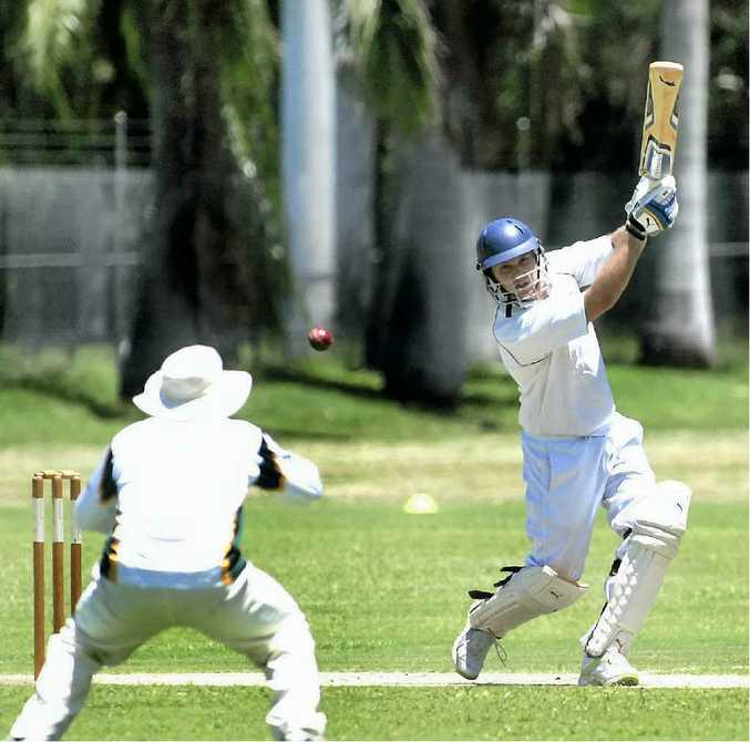 Norths batsman Terry Wreghitt goes for his shot.