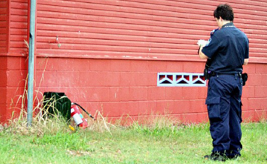 A police officer at the Moura Memorial Club late yesterday afternoon.