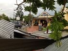 A business has lost its roof in the main street of Cooroy during today's ferocious storm. Picture: Andrew Wyatt via Facebook