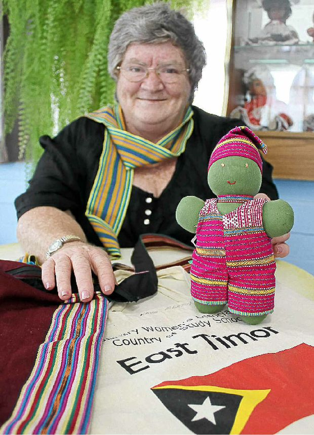 Kaye Martin with some of the items woven by East Timorese women that she bought at the CWA Study School last weekend.