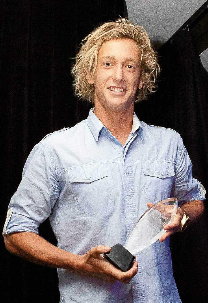 Mooloolaba Surf Life Saving Club's Ali Day shows off his Red Bull award.