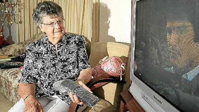 Dorothy Edwards has a moment with her old TV before upgrading to digital later this year.