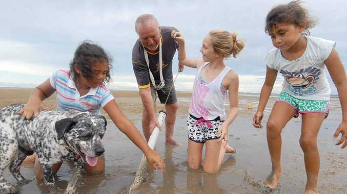 Billy Jack and his grand-daughters Madison Burns, Darcy Brown and Tayla Wang and Sam the dog find plenty to do at Town Beach.