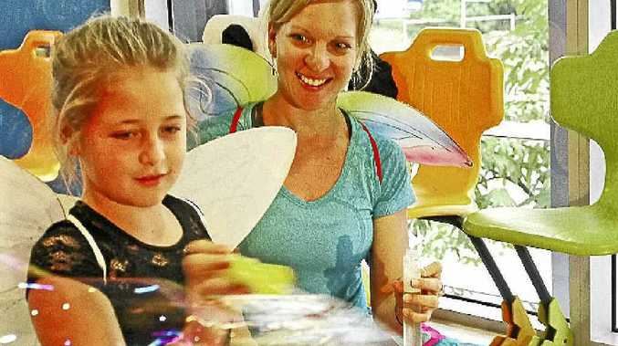 Grace Voller participates in a yoga program with Stacey Elmes at Nambour General Hospital.