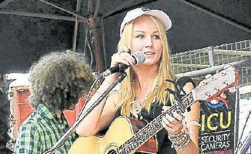 Talented: Grace Sleeman performs at the Tamworth Country Music Festival with Aiden Patrick.