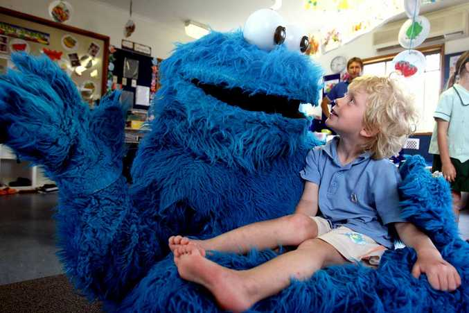 The Cookie Monster visits Cherubs Preschool and Early Learning Centre and meets three-year-old Joseph Maguard.