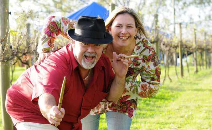 John Morrison and Jacki Cooper in the vineyard at Dingo Creek winery.