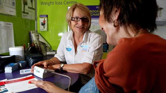 Elaine Thurgood, of Tugun Chemmart Pharmacy, testing blood pressure.