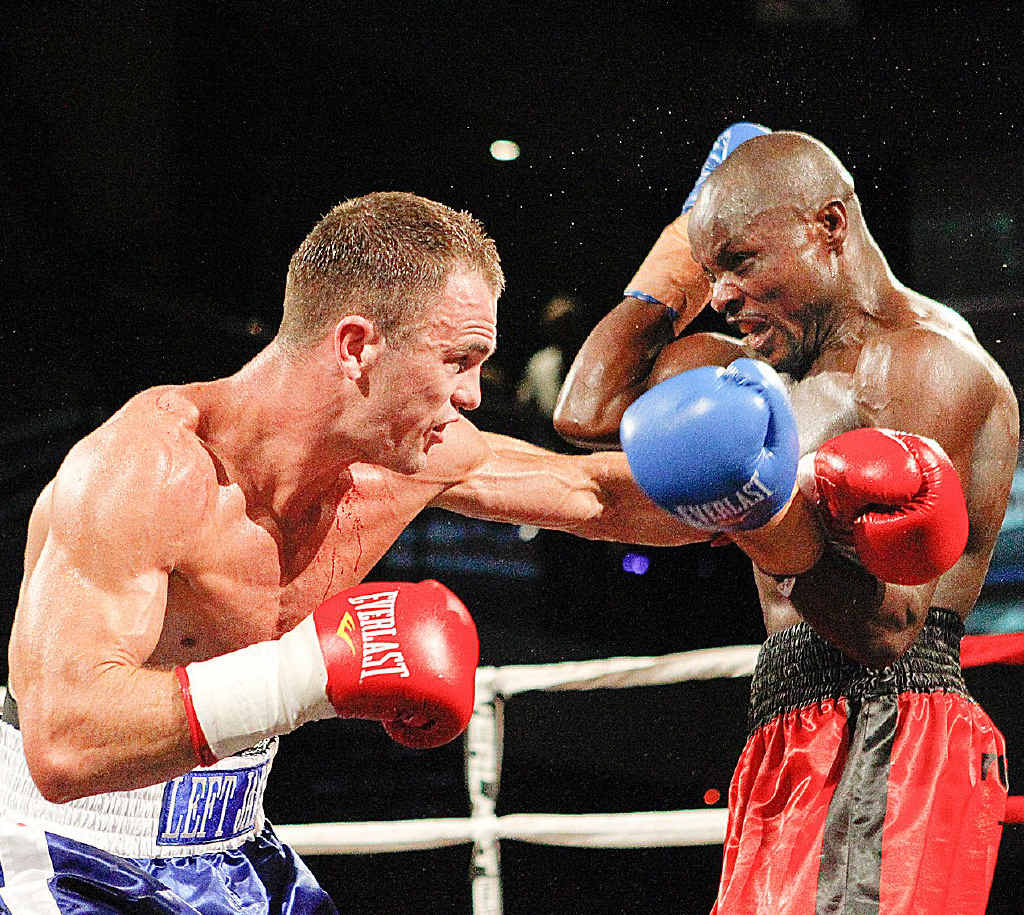 Hervey Bay's Jarrod Fletcher lands a big left on former Australian middleweight champion Johannes Mwetupunga during their showdown in Melbourne on Friday night. Fletcher won the bout on a unanimous points decision.