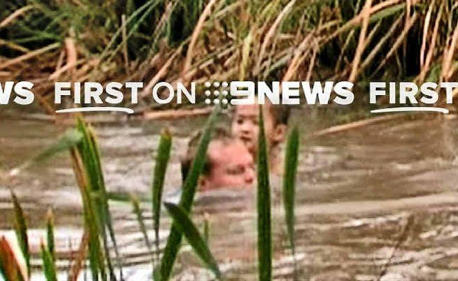 Nine Network cameraman and former Rockhampton man Glenn Edwards rescues missing Vietnamese boy Ryan Pham from a swollen Kororoit Creek after heavy rainfall yesterday.