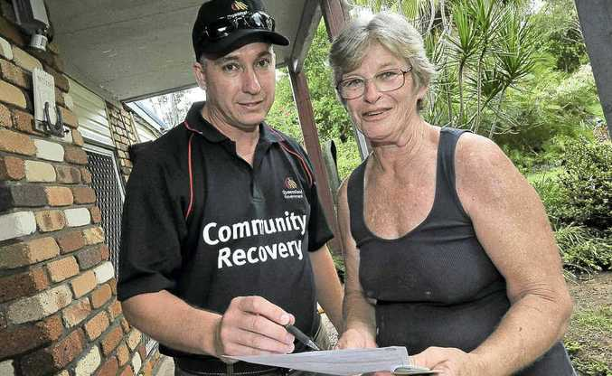 Mary Lehane receives assistance from Department of Communities worker Steve White.