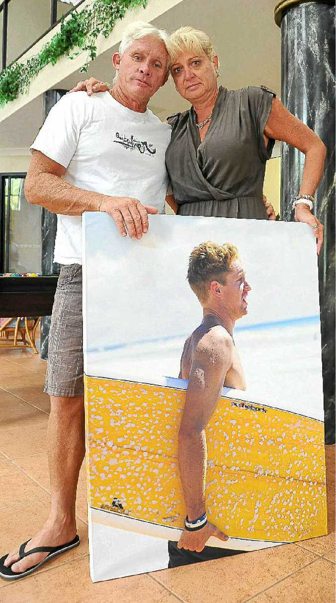 Gerry and Terrina Geltch with a photo of their son Dayne taken three days before his death.