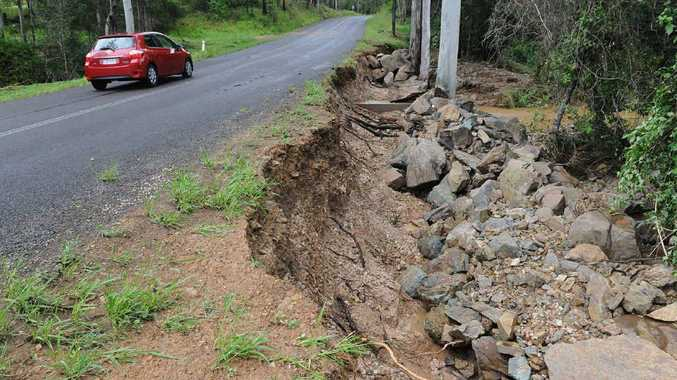Flash flooding to the south of Gympie on the Bruce Hwy and Traveston Crossing left the side of this road worse for wear.