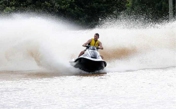 Jetskis have a great time on the flooded Gympie Touch Association fields on Sunday.