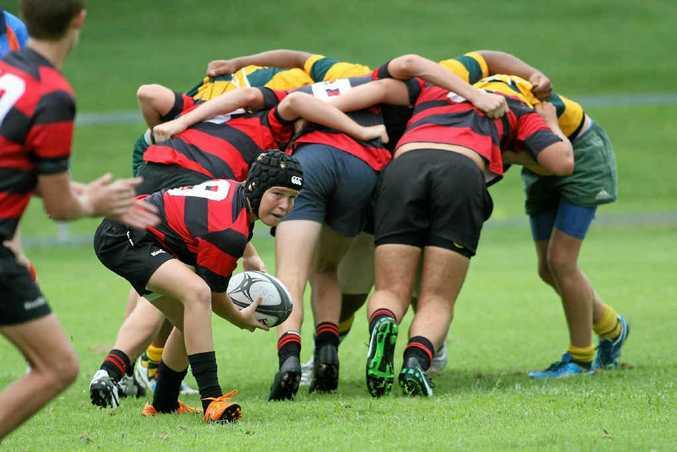 Rockhampton Grammar's Mason Jones sends his pass following a scrum win during the Under-15 Rugby Sevens game against St Brendan's.