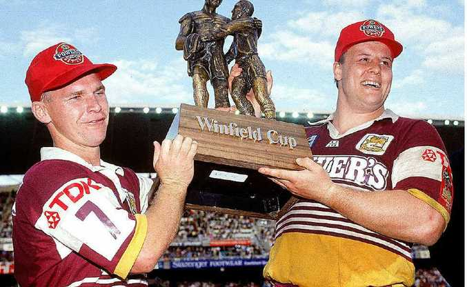 Allan Langer (left) and Glenn Lazarus of the Broncos with the premiership trophy after downing the Dragons.