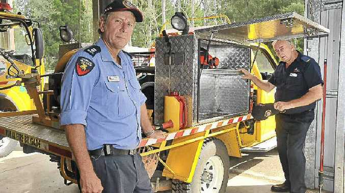 Beerwah Rural Fire Brigade first officer Lou Spann and secretary Greg Sutton at the burgled headquarters.