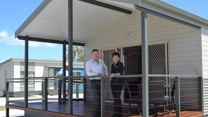 BOWLO CABINS: Evans Head Bowling Club manager Roger Hong and cabin manager Margaret Stewart stand on the verandah of one of two cabins with disabled facilities. Photo Samantha Elley / Rivertown Times