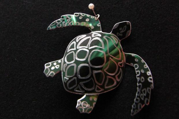 A stainless steel turtle pendant from Mojo Creations. Photo Sophie Jackson / Capricorn Coast Mirror