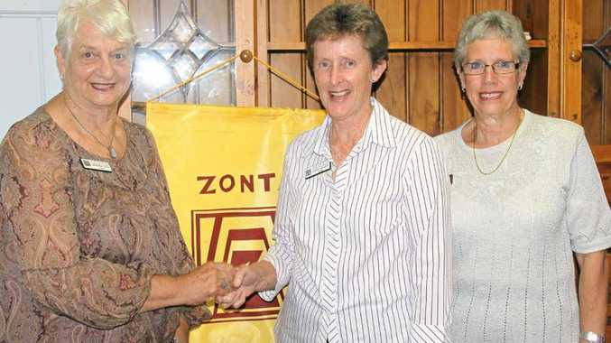 Gympie Zonta Club president Barb Yule (left) and Zonta's Area 1 director Bev Bellett (right) welcome new member Sandy Linnane.
