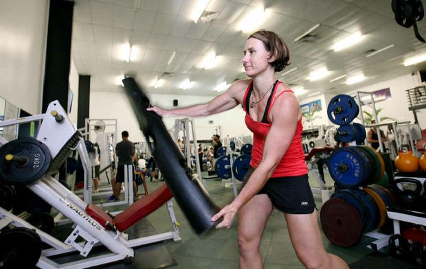 Shift worker Jenny Smith uses a Vipr Pole at City Fitness Health Club. Ms Smith said she would make use of the health club's 24-hour gym, which is due to open in March.