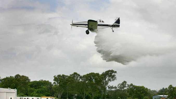 Richard McDonald demonstrates his water bombing aircraft at Rockhampton airport.
