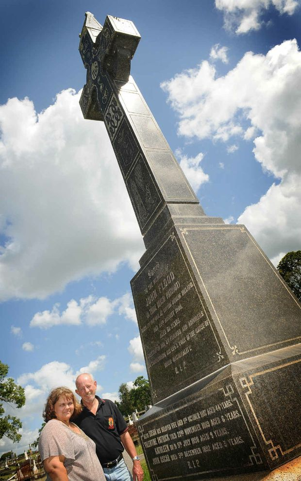 Di and Woody Woodstock at the grave of John Flood in the Gympie Cemetery. His story and those of seven other Gympie pioneers will be shared with local history lovers at theGympie Family History Society's cemetery crawl.