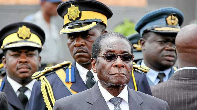 A Coast couple was accused of plotting to kill Zimbabwe President Robert Mugabe.