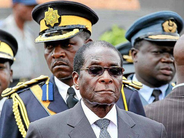 A Coast couple was accused of plotting to kill Zimbabwe President Robert Mugabe.