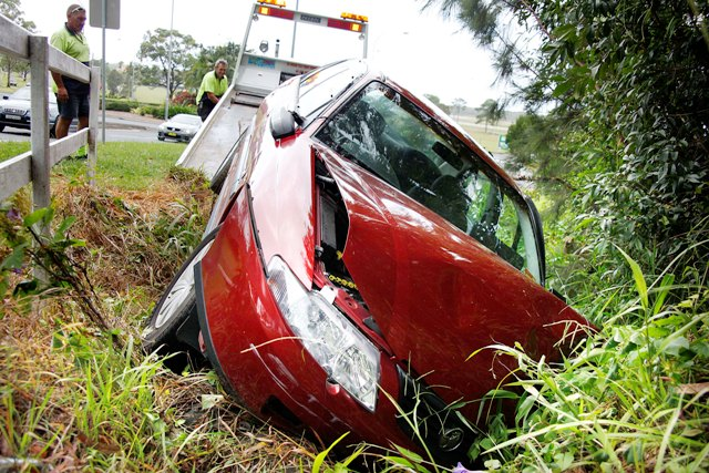 A driver got a scare this morning after crashing her Holden Commodore in Albany St in wet conditions.