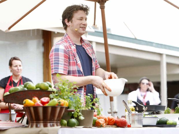 Celebrity chef Jamie Oliver gives a live cooking demonstration during his visit to Ipswich on Saturday.