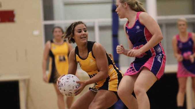 Ella Lawrie pounces on a loose ball against Wide Bay.