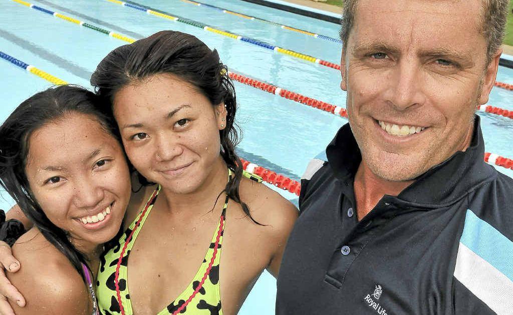 Kazumi Yasuhira, Yuki Sakamoto and pool lifeguard Ian Thomson embrace a new Anzac Pool initiative to help bridge cultural divides.