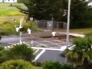 Youths' mad dash to beat a train