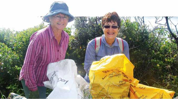 CLEANING UP: Fran Byrne (left) and Kathy Brady cleaning up at Lighthouse Lookout in Ballina. PHOTO: GRAHAM BROADHEAD