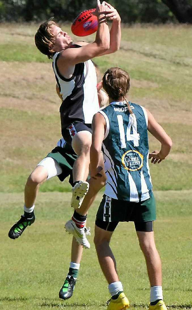 BITS Saints Jamie Cunninghame goes high to claim a mark in the match with Gladstone last season.