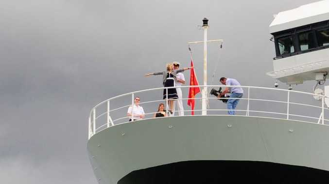 The Project's Anna Daniels strikes the Kate Winslet Titanic pose on The Queen Mary 2 cruise ship when it docked in Darwin.