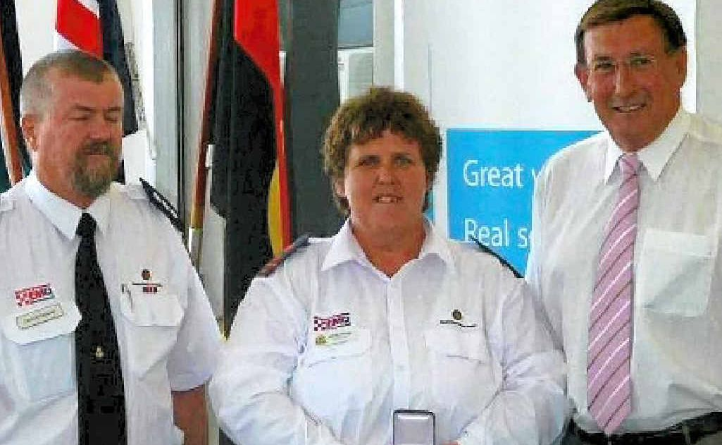 Ann McGlashan (centre) receiving Achievement Medallion on Australia Day in 2011 with area director EMQ Toowoomba Chris Artiemiew and MP Kerry Shine.