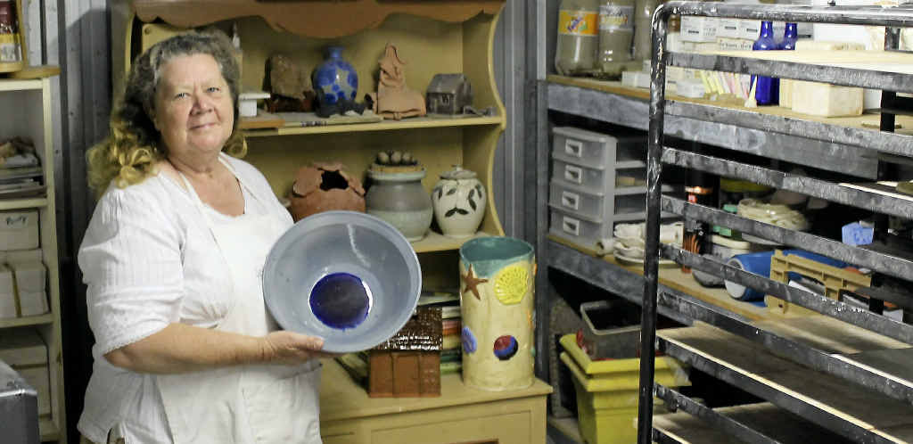 President of Warwick Potters Association and steward for the show's pottery section Sue Creed shows off her prize-winning creation.