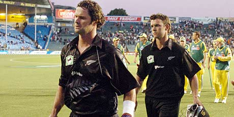 Chris Cairns (left) leaves the field after a Black Caps match.
