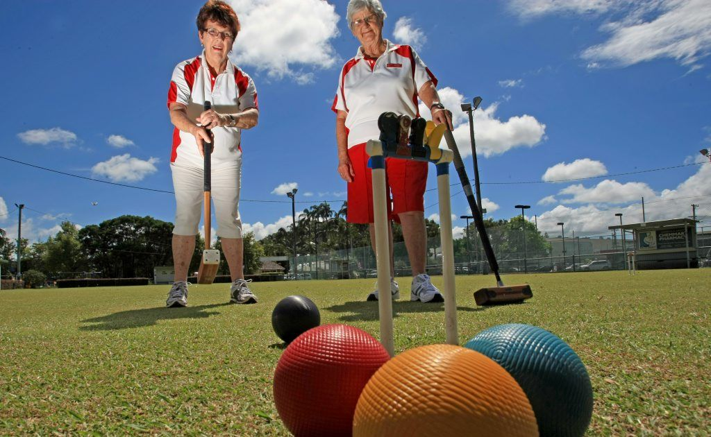 Joy Hughes and Marg Mitchell have a game of croquet at Murwillumbah Croquet Club.