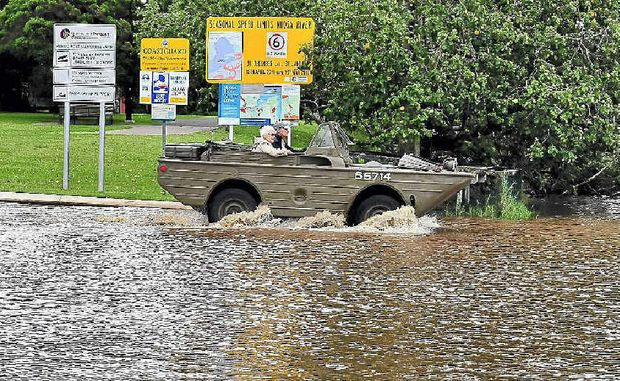 John and Naomi Summers drive home by road after cruising up the Noosa River in their amphibious vehicle.
