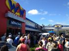 Crowds waiting outside WOW in Maroochydore for day one of the chain's closing down sales.
