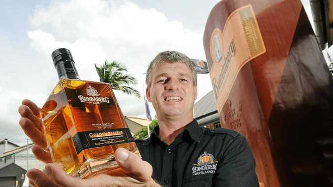 Bundaberg rum bond store manager Hayden Jobson with the latest bottle of rum.