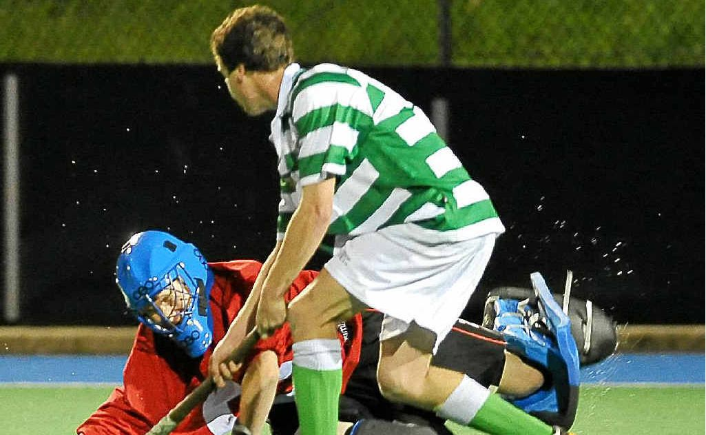 Bears goalkeeper Aiden Cameron dives to prevent a shot on goal by a Royals player in last season's A-grade grand final.